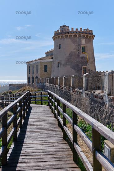 Fenced wooden bridge leading to watchtower. Pilar de la Horadada. Spain