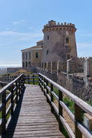 Fenced wooden bridge leading to watchtower. Pilar de la Horadada. Spain