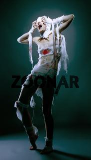 Studio shot of slim model posing as scary mummy