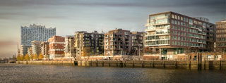 Panorama of the Hafencity in Hamburg at sunset with the Elbphilharmonie
