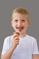 Happy baby boy ready for eating chocolate ice cream
