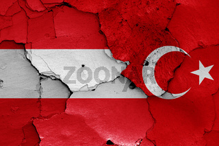 flags of Austria and Turkey painted on cracked wall