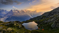 beautiful sunset by the lake under the snowy Mont Blanc