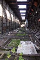 an old destroyed train car, an abandoned train. Devastation