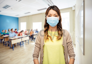 asian young woman in protective medical mask