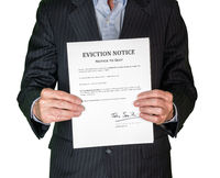 Man in suit giving eviction notice to renter or tenant of home
