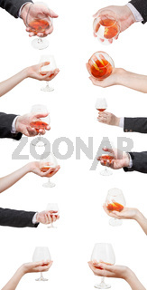 set of brandy glasses in hand isolated