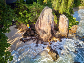 Man on beach at Seychelles aerial top view