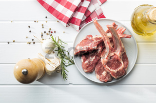 Slices raw lamb chops on plate