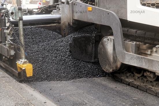 Asphalt paver repairing the street