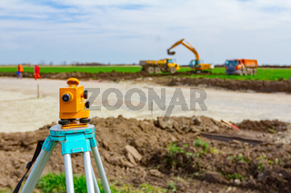 Geodesist device on tripod on a building site