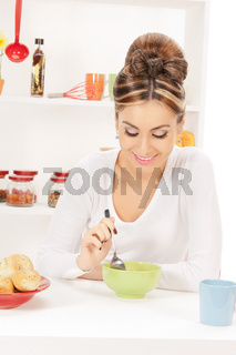 lovely housewife with cup of muesli