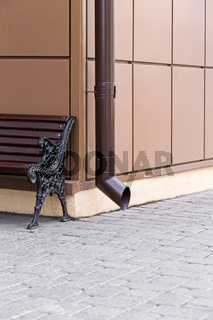Downspout and bench