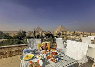 Egyptian breakfast overlooking the Great Pyramid of Giza, the Pyramid of Khafre, and the Pyramid of Menkaure