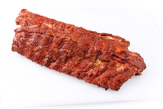 Raw pork spare loin ribs St Louis cut with spicy rub offered as closeup on white background with copy space free-from select