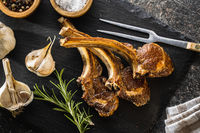 Grilled lamb chops on cutting board.