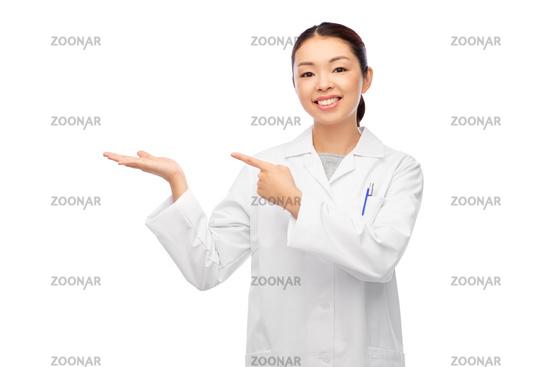 asian female doctor holding something on hand