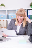 Businesswoman working indoors at home office. Work, communication and business concept.