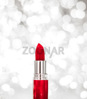 Red lipstick on silver Christmas, New Years and Valentines Day holiday glitter background, make-up and cosmetics product for luxury beauty brand