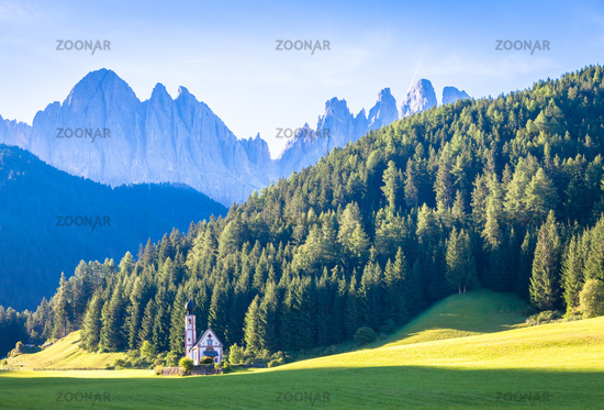 View of the small church of St. John in Ranui, Dolomites mountain, Italy