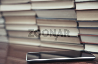 Books and digital tablet
