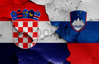 flags of Croatia and Slovenia painted on cracked wall