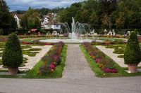 fountain in park of baroque castle