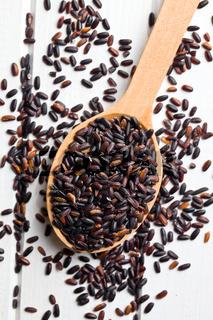 black rice on wooden spoon