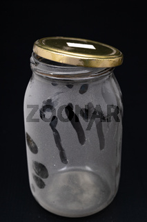 One dusty glass jar. A container for preparing home mortars.