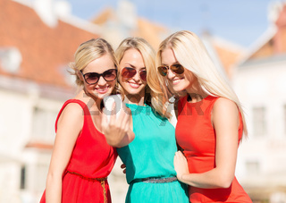 beautiful girls taking picture in the city