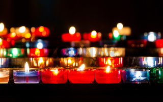 Colorful candles in church