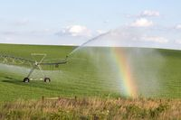 Pivot running in field with beauful rainbow on sunny day . July 22, 2019, O'Nell, Holt county, Nebra