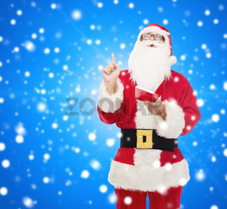man in costume of santa claus with notepad