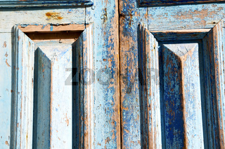 dirty stripped paint in the blue  and rusty nail