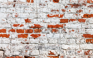 Brick wall stained with white paint as background