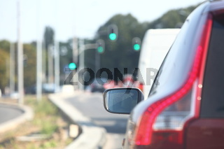 car within traffic jam in rush hour highway in city