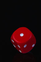 Red dice on the black background.