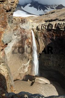 Dangerous Canyon, waterfall under active Mutnovsky Volcano. Kamchatka Peninsula