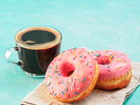 pink donuts on blue background , copy space