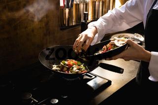 Caucasian chef cooking vegetables