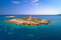 Aerial view of lonely island with lighthouse, Korcula riviera island Vela Sestrica