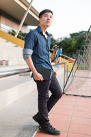 Handsome guy standing at staicase with hand in pocket - Casual fashion style of asian men in Vietnam