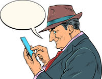 An elderly businessman with a smartphone. The boss looks at the messages