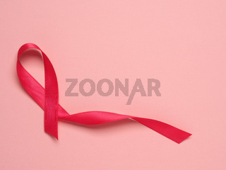 Pink ribbon curl on a pink paper background ,symbol for Liver Cancer awareness, World Cancer Day