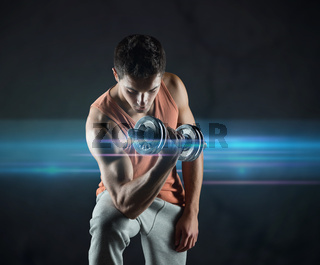 young man with dumbbell flexing biceps