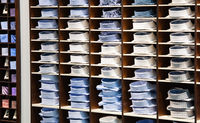 Summer and winter fashion men's shirts on a shelf for winter sales