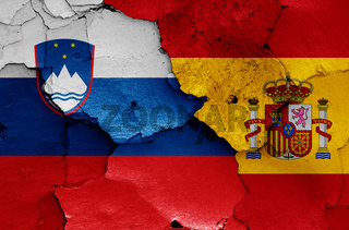 flags of Slovenia and Spain painted on cracked wall