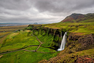 Seljalandsfoss waterfall in a cloudy day, Iceland