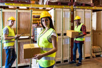 White warehouse worker hold boc portrait with her colleague