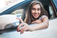 Beautiful girl enjoy her road trip.